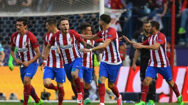 Saul Niquez celebrates with team-mates after scoring Atletico's opening goal