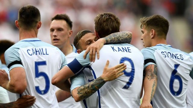 Kane is congratulated by his England and Spurs team-mate Kieran Trippier
