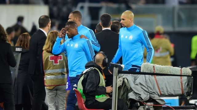 Evra leaves the pitch after an incident with Marseille supporters before the start of their match with Vitoria Guimaraes