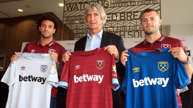 Pellegrini (centre) brought in nine new players including Felipe Anderson and Jack Wilshere during the summer