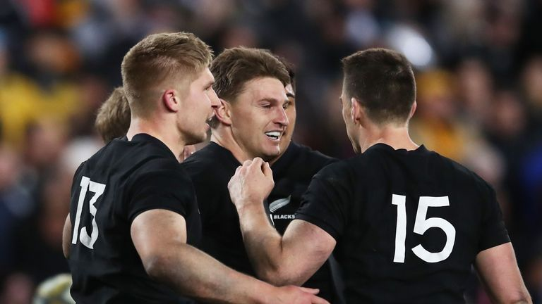 Beauden Barrett celebrates with team-mates after scoring against Australia