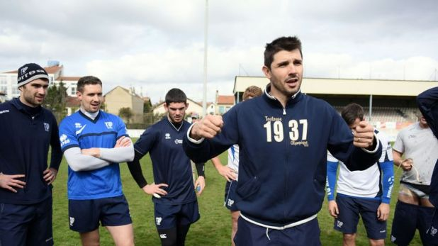 Toulouse coach Sylvain Houles addresses players during a training session