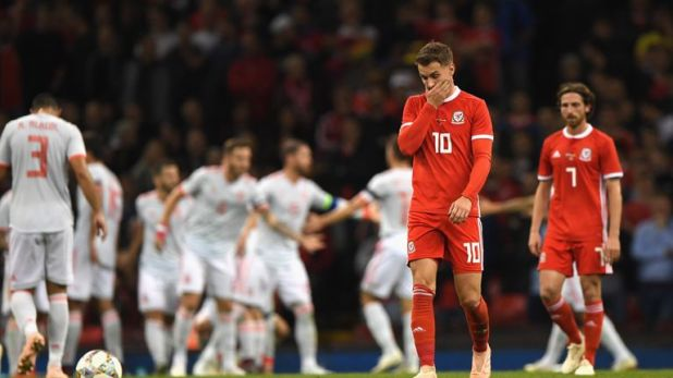 Aaron Ramsey and Joe Allen look dejected as Spain cruised to a 3-0 half-time lead