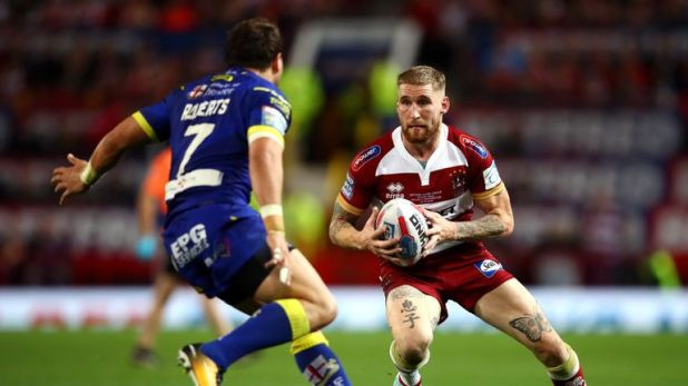 Wigan's Sam Tomkins runs into Warrington's Tyrone Roberts in a fiercely fought Grand Final