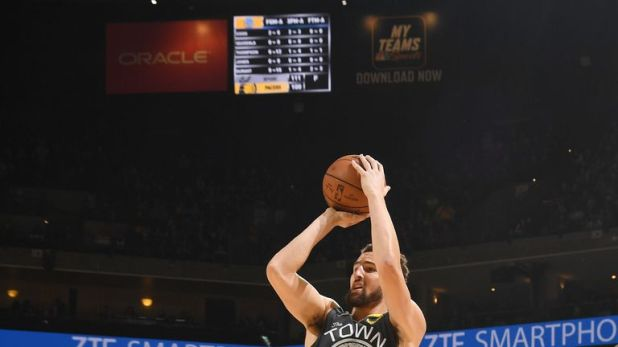 Klay Thompson shoots a jump shot against Portland