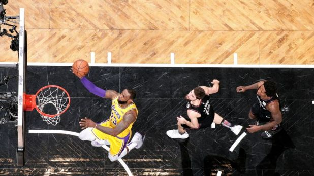 LeBron James scores with a lay-up against the Brooklyn Nets