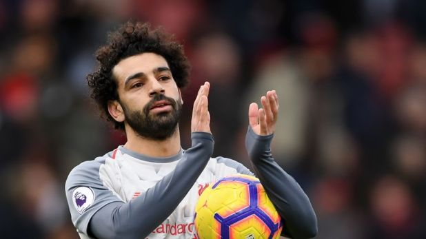 Salah with the match ball after the game at the Vitality Stadium
