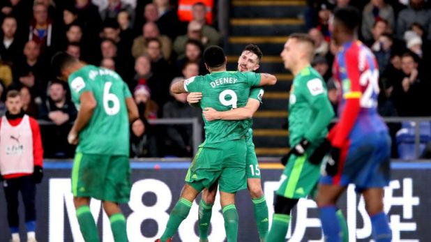 Craig Cathcart celebrates his goal with team-mate Troy Deeney