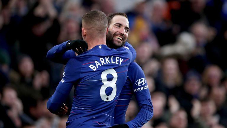 Gonzalo Higuain celebrates his second goal with Ross Barkley