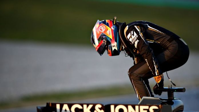 A familiar feeling for Romain Grosjean: jumping out of his sick Haas.