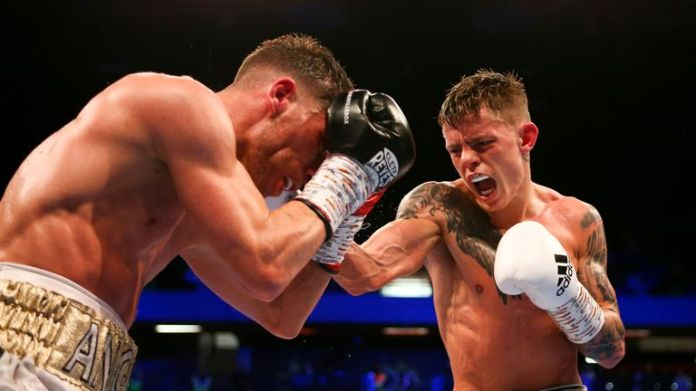 Charlie Edwards attacks Angel Moreno during his defense of the WBC flyweight title