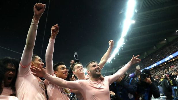 Manchester United players celebrate following their victory over PSG