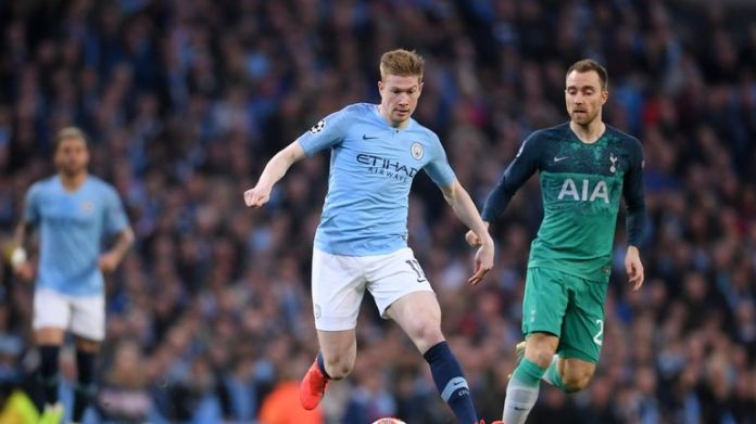 Kevin De Bruyne moves away in a hectic first half of Christian Eriksen