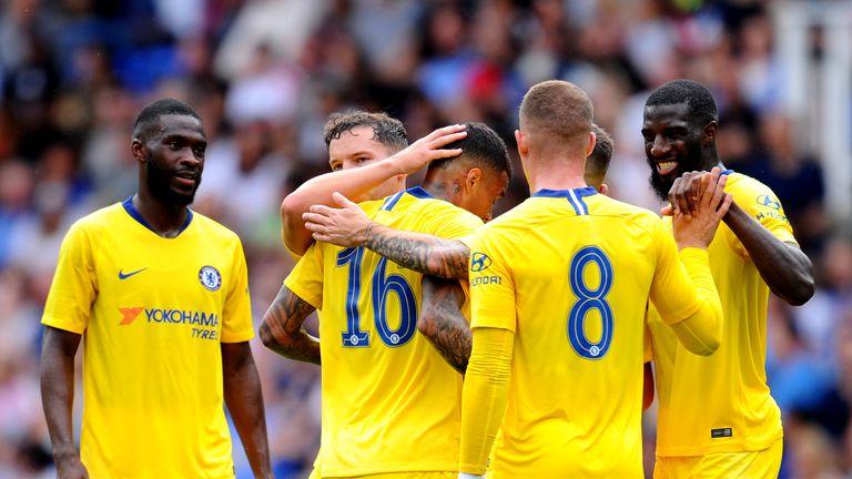 Chelsea players celebrate Kenedy's goal against Reading
