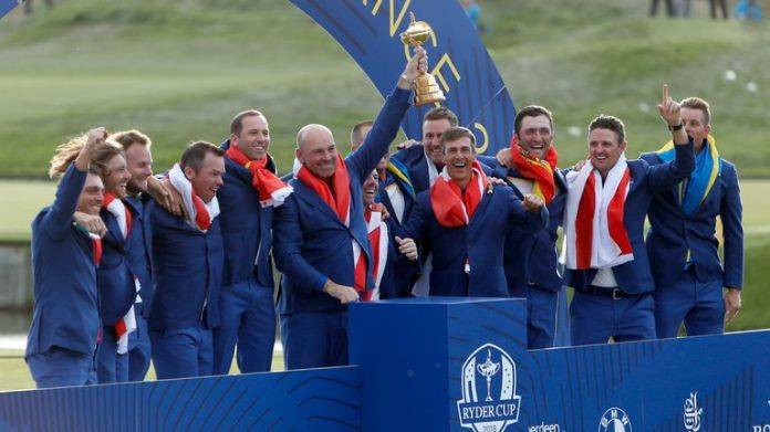 Europe team captain Thomas Bjorn holds up the trophy after guiding Europe to victory in 2018
