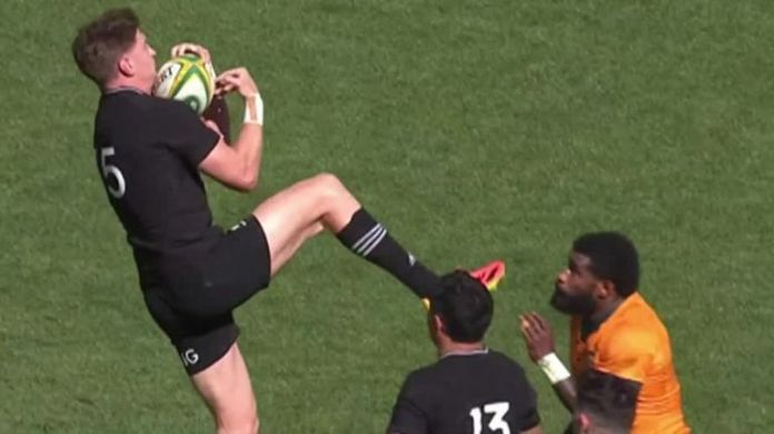 Jordie Barrett has been red carded for contact with the head after jumping for a high ball