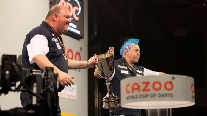 John Henderson and Peter Wright celebrate their World Cup of Darts triumph