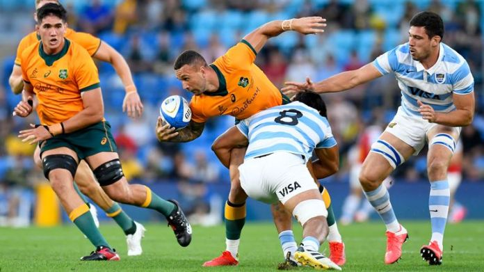 Quade Cooper looks to offload out of the tackle