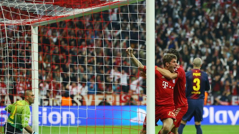 Thomas Muller celebrates scoring against Barcelona at the Allianz Arena in 2013