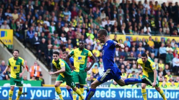 Jamie Vardy opens the scoring for Leicester against Norwich.