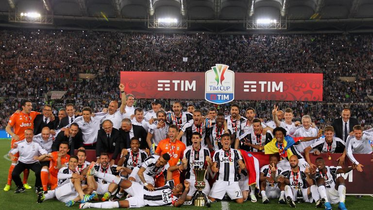 Juventus celebrate with the trophy