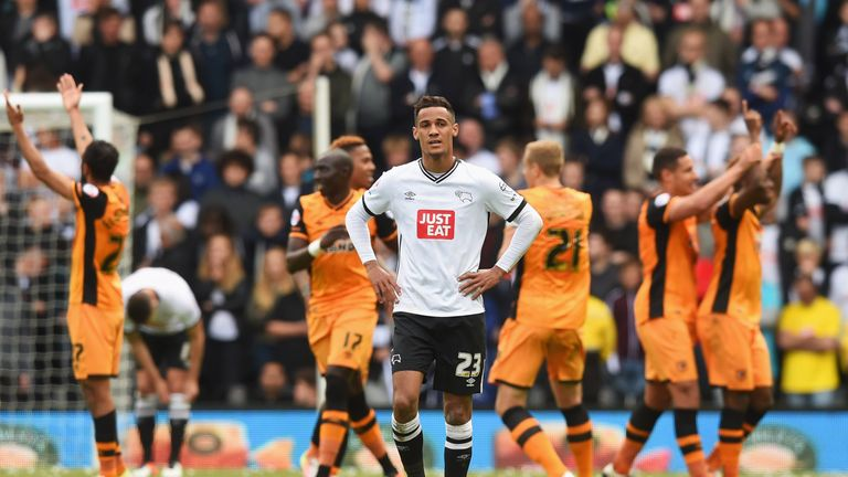 Tom Ince of Derby County looks dejected as Hull City players celebrate in the first-leg defeat