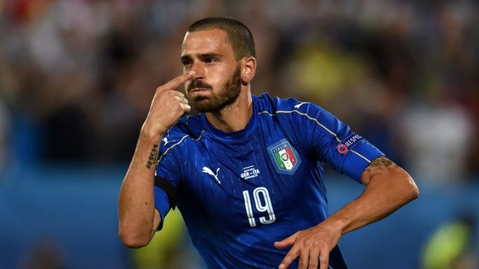 Leonardo Bonucci celebrates scoring for Italy from the penalty spot