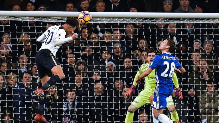 Alli directs his looping header into the top corner to put Spurs ahead