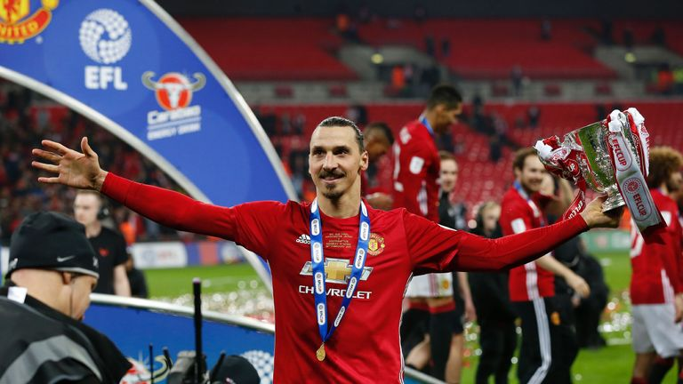 Ibrahimovic celebrates with his first trophy in England, the EFL Cup