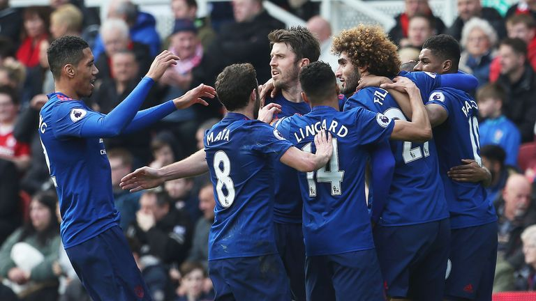 Fellaini celebrates his goal with team-mates