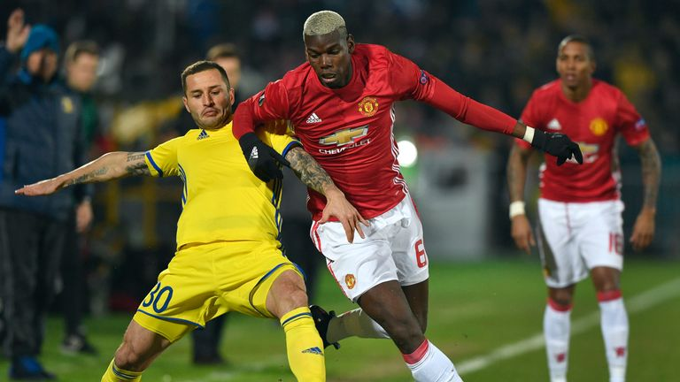 Paul Pogba fights for the ball with Rostov defender Fyodor Kudryashov