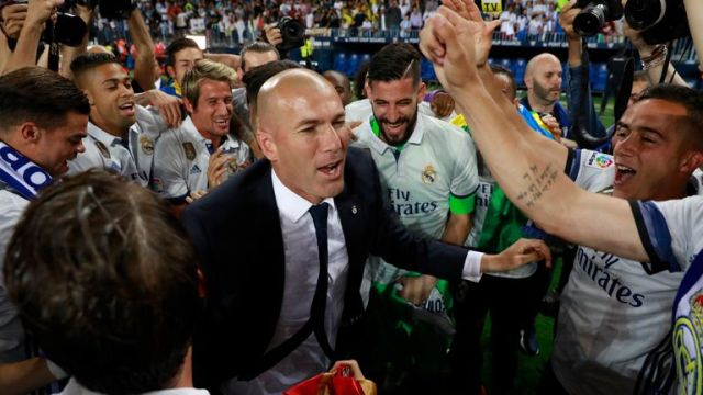 Zinedine Zidane celebrates with his players after clinching La Liga
