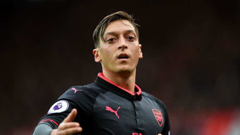 Mesut Ozil is in talks over a new Arsenal deal and Wenger 'genuinely thinks' the midfielder will stay at the club