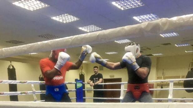 Usyk called Chamberlain back into his camp