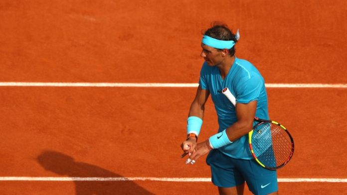 Nadal stretches his fingers after suffering from cramp Rafael Nadal beats Dominic Thiem to win record-extending 11th French Open title | Tennis News Rafael Nadal beats Dominic Thiem to win record-extending 11th French Open title | Tennis News skysports rafael nadal tennis 4332617