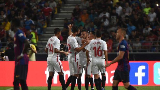 Sevilla celebrate Pablo Sarabia's opening goal
