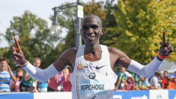 Eliud Kipchoge crosses the finish line of the Berlin Marathon in a world record time