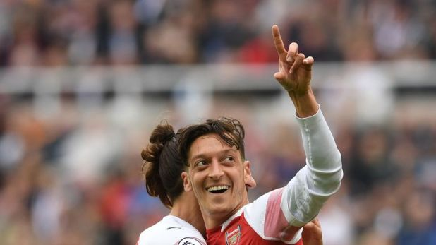 Mesut Ozil missed Arsenal's 5-1 win at Fulham after suffering a back spasm