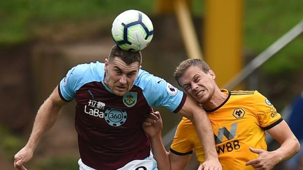 Sam Vokes (L) vies with Wolves defender Ryan Bennett