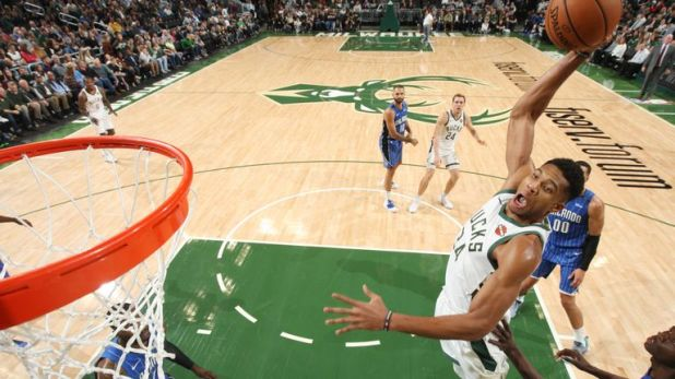 MILWUAKEE, WI - OCTOBER 27:  Giannis Antetokounmpo #34 of the Milwaukee Bucks dunks the ball against the Orlando Magic on October 27, 2018 at the Fiserv Forum in Milwaukee, Wisconsin. NOTE TO USER: User expressly acknowledges and agrees that, by downloading and or using this Photograph, user is consenting to the terms and conditions of the Getty Images License Agreement. Mandatory Copyright Notice: Copyright 2018 NBAE (Photo by Gary Dineen/NBAE via Getty Images)