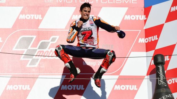 Marc Marquez jumps for joy after claiming his third consecutive MotoGP title with victory in Japan