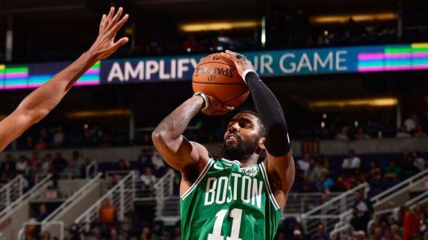 Kyrie Irving fires a jump shot aginst Phoenix