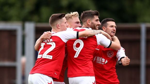 Ched Evans celebrates with Fleetwood Town team-mates