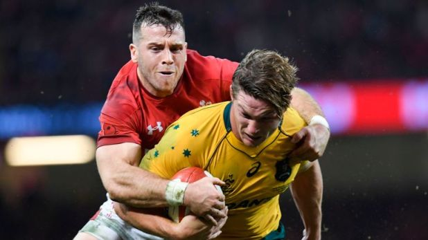 Wales scrum-half Gareth Davies tackles Wallabies captain Michael Hooper