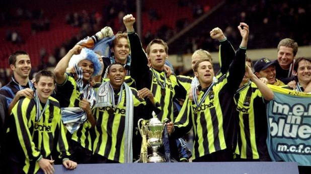 Manchester City's players celebrate after winning promotion in 1999