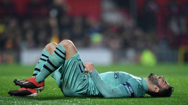 Kolasinac lies on the floor in despair after his error