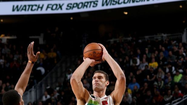 Brook Lopez fires from beyond the arc against Detroit