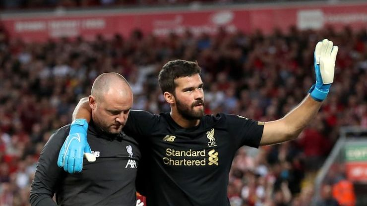 Alisson leaves the pitch after picking up an injury