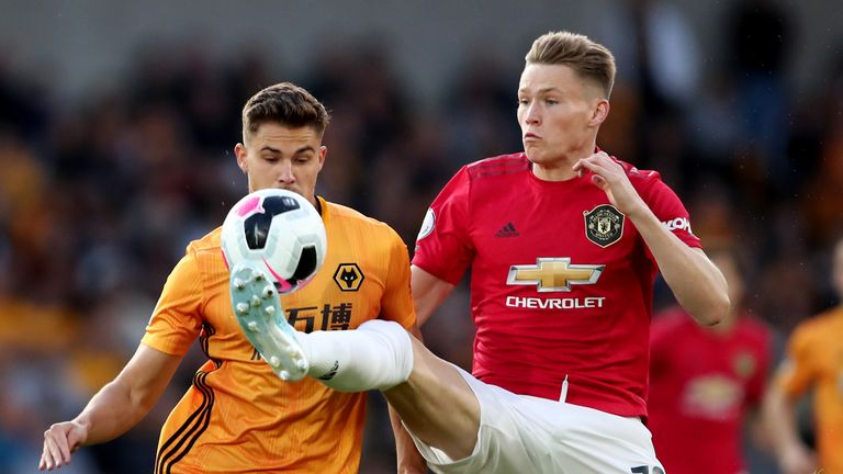 Scott McTominay battles for the ball