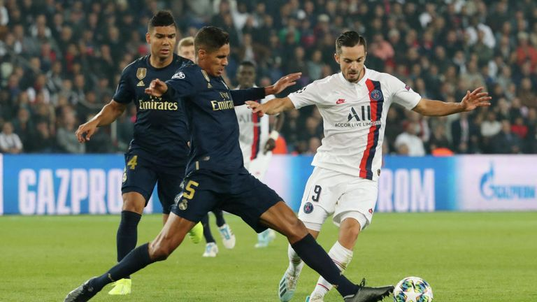 Raphael Varane and Pablo Sarabia battle for the ball in the Champions League Group A opener